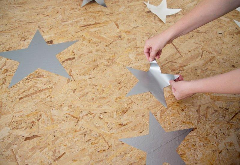 stervorm patroon schilderen op houten vloer